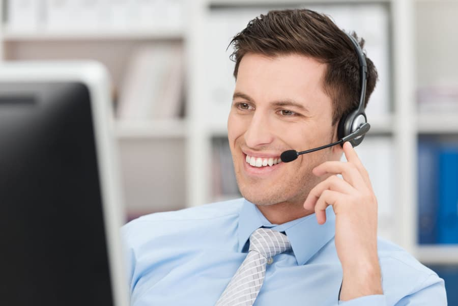 Smiling friendly male call centre operator
